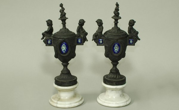 23:  Pair of Cast Metal Figural Covered Urns