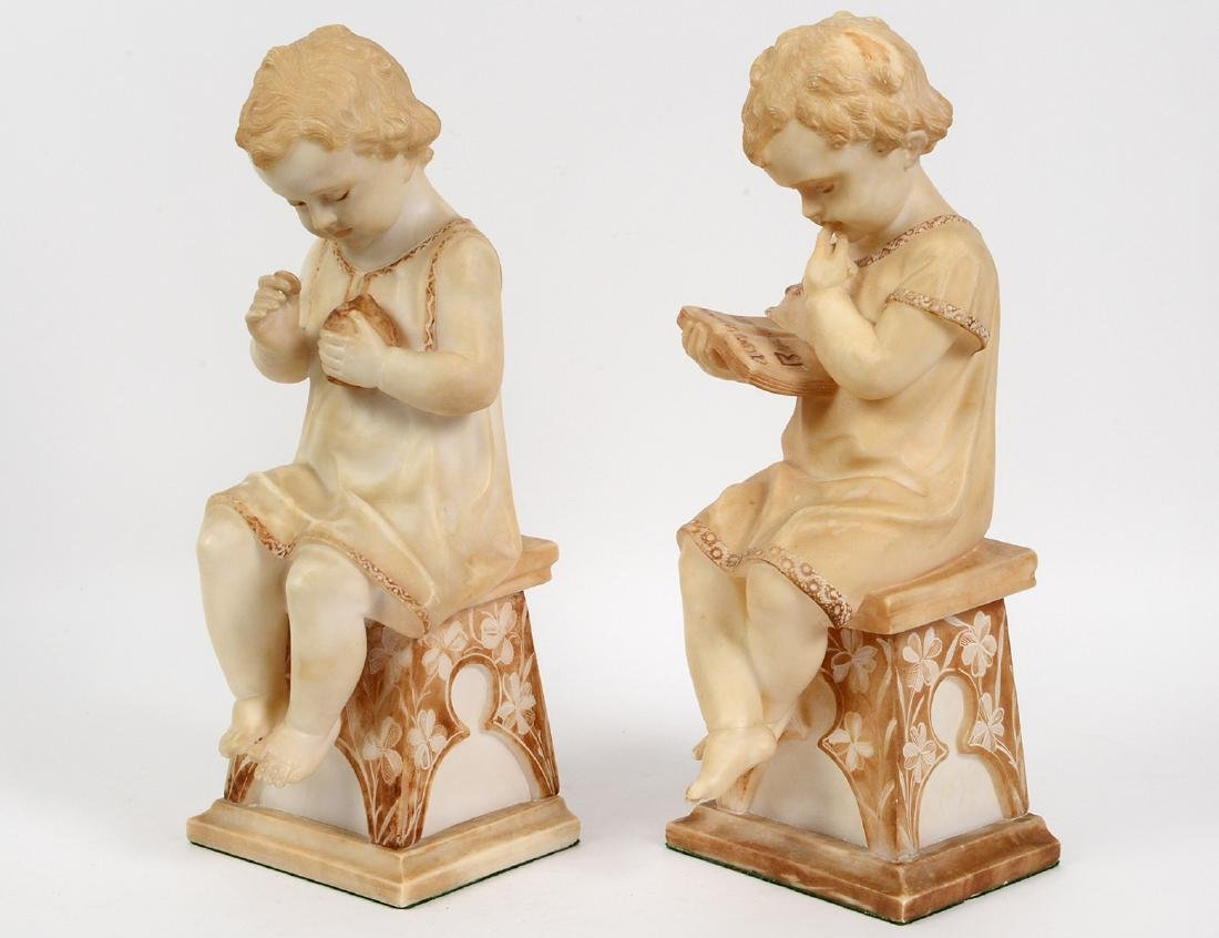 PAIR OF ITALIAN MARBLE FIGURES OF SEATED CHILDREN