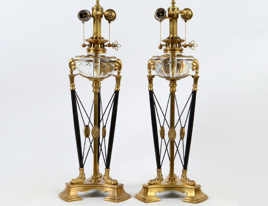 PAIR OF CROFTON VARIOUS METAL AND GLASS TRIPOD LAMPS