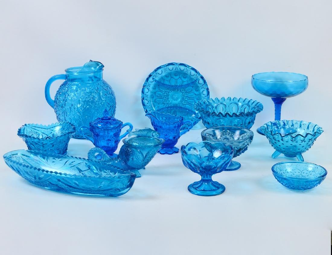 THIRTEEN MOLDED BLUE CARNIVAL GLASS TABLE ITEMS