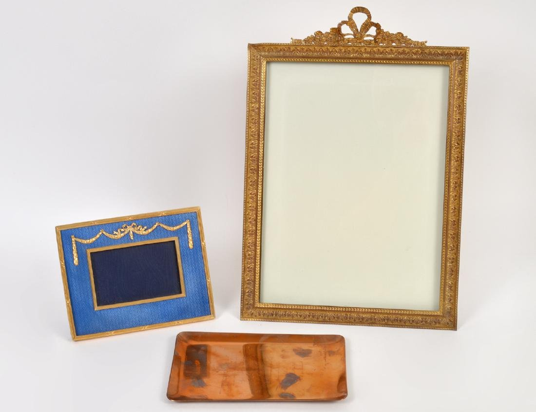 TWO GILT METAL PICTURE FRAMES & CARTIER METAL DESK TRAY