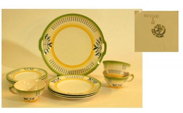 1006: Ten-Piece Hand-Painted Dutch Pottery Dinnerware
