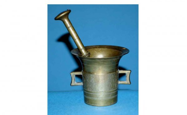 1011: Brass Mortar and Pestle. Mortar is 4 ¼ inches hig