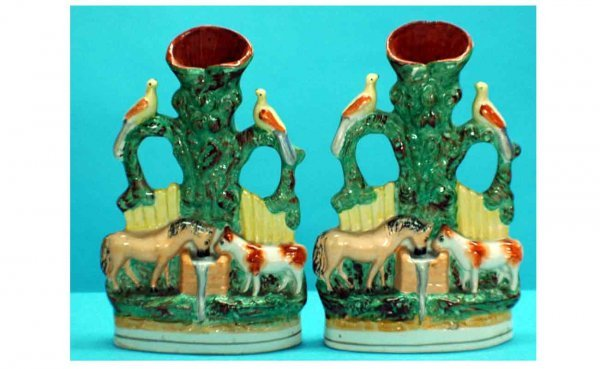 1022: Pair of Early Staffordshire Spill Vases with Hors