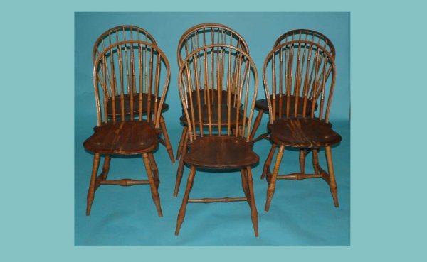 21: Seven (7) Wooden Windsor Chairs with curved comb-ba