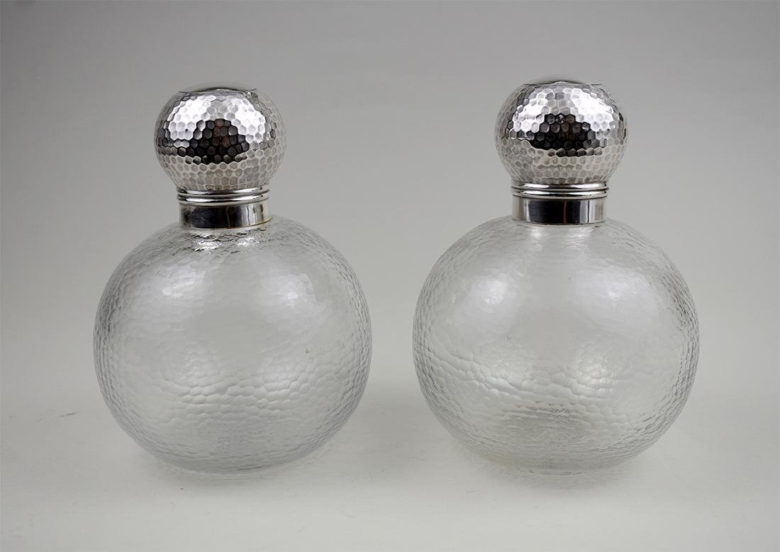 PAIR OF EDWARDIAN SILVER-MOUNTED GLASS BOTTLES