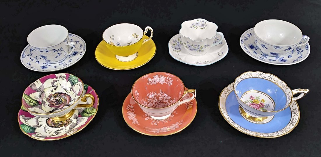 GROUP OF SEVEN PORCELAIN CUPS AND SAUCERS