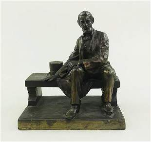 VINTAGE BRASS FIGURE OF LINCOLN SEATED ON A BENCH