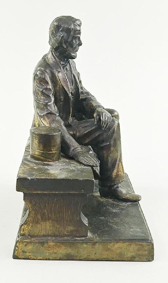 VINTAGE BRASS FIGURE OF LINCOLN SEATED ON A BENCH - 6
