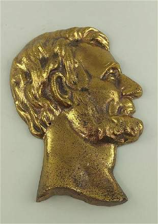 BRASS PLAQUE OF A LINCOLN BUST IN PROFILE