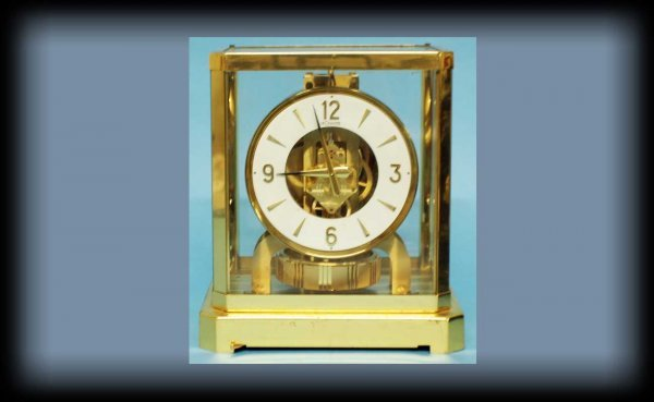 1018: LeCoultre Atmos Annular Brass & Glass Clock In Wo