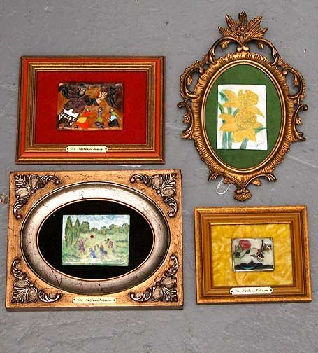 1010: Group of four framed plaques.