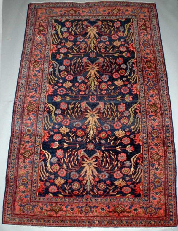 21: Persian Lillihan Rug, The dark blue ground woven wi