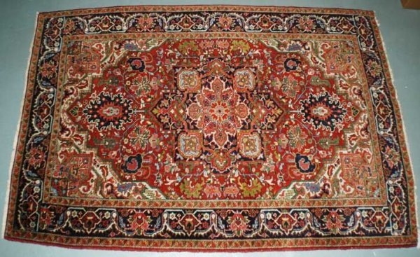22: Persian Heriz Carpet,The beige ground woven with a