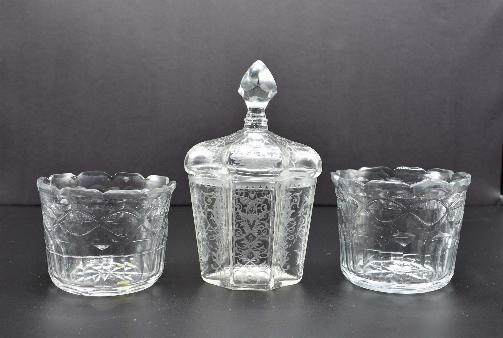 PAIR OF COLORLESS GLASS WINE RINSERS & A COVERED JAR