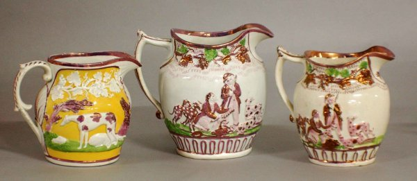 9: GROUP OF THREE STAFFORDSHIRE POTTERY PITCHERS