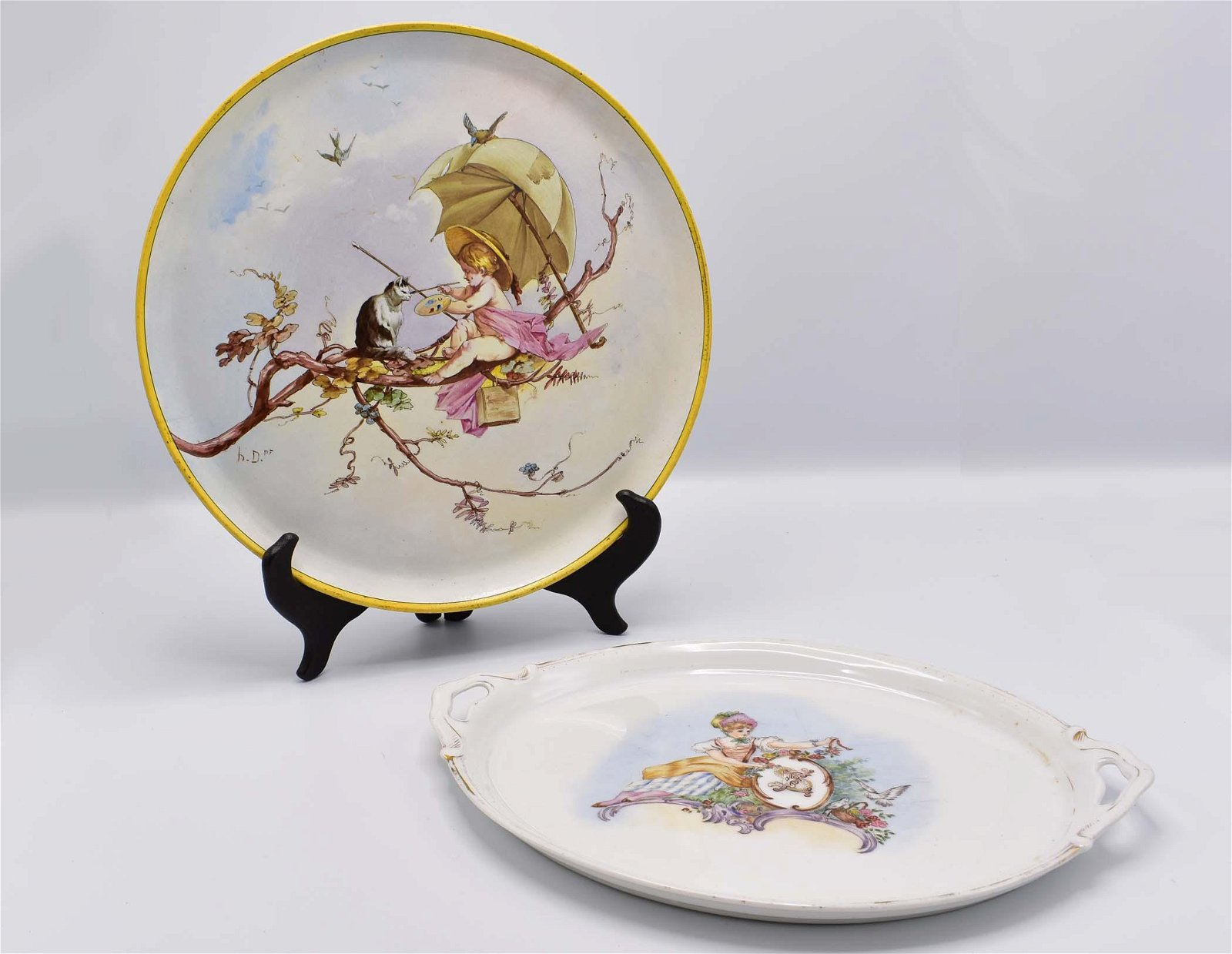 FRENCH FAIENCE PLATTER AND A PORCELAIN  PLATTER