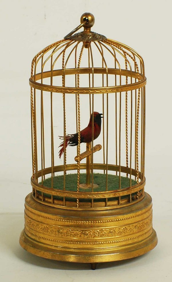 1021: GILT METAL SINGING BIRDCAGE