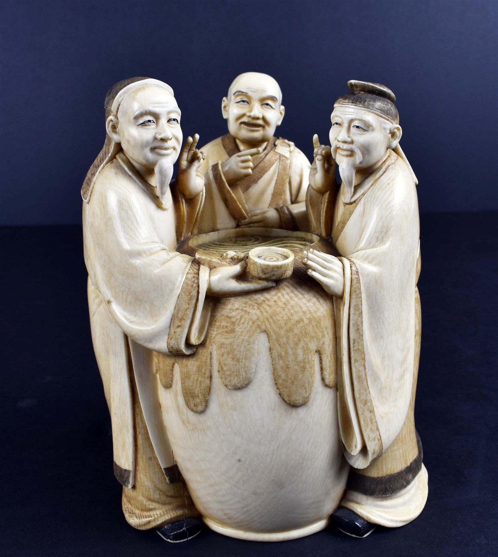 JAPANESE OKIMONO OF THREE SAKE TASTERS