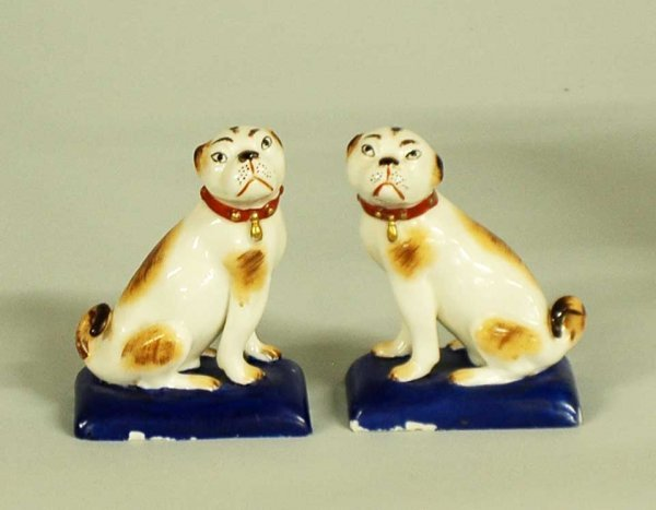 5: PAIR OF PORCELAIN FIGURES OF PUGS
