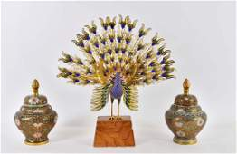 TWO CHINESE CLOISONNE ENAMEL COVERED JARS  A PEACOCK