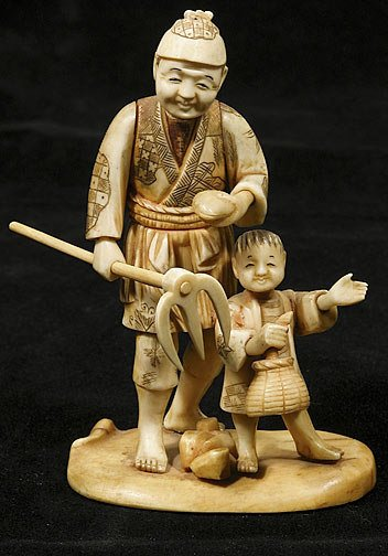 13: Japanese Ivory Okimono Man with Boy and Hoe