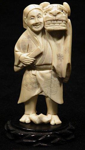 16: Japanese Ivory Okimono Man Holding a Dragon