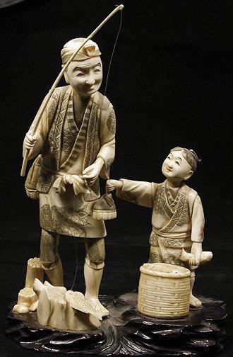 18: Japanese Ivory Okimono Fisherman and Boy with Fish