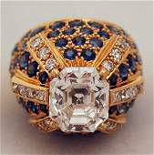 1122: IMPORTANT DIAMOND AND SAPPHIRE DOME RING