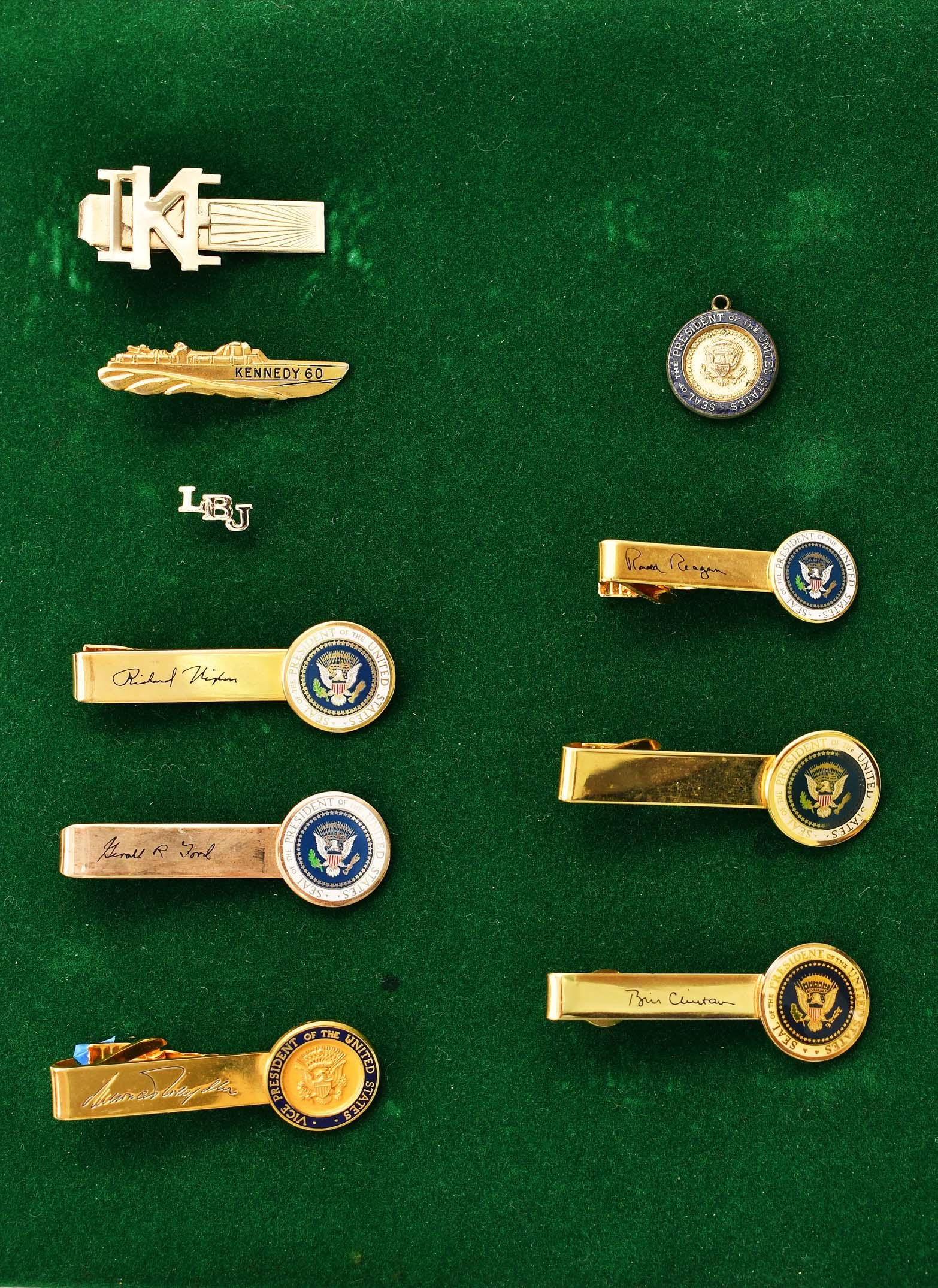NINE PRESIDENTIAL TIE BARS, A PIN AND A MEDAL