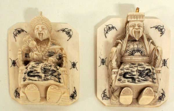 10: TWO CARVED AND ETCHED IVORY PLAQUES