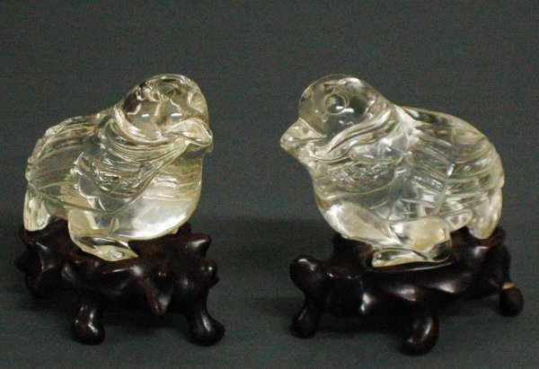 15: PAIR OF CARVED CRYSTAL FIGURES OF BIRDS