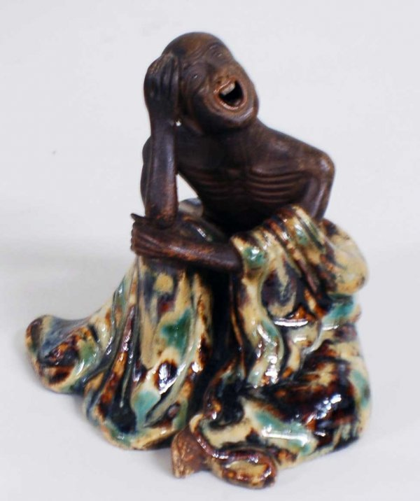 1006: PARTIALLY GLAZED POTTERY FIGURE OF A MONK