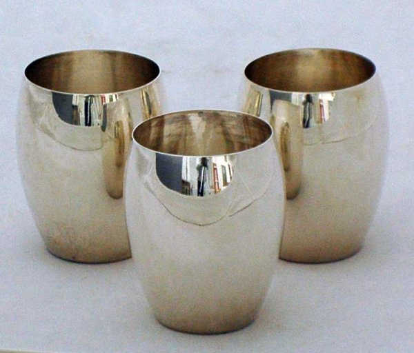 1009: SET OF SIX SILVER CUPS