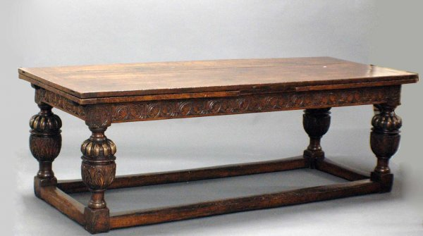 1075: ELIZABETHAN STYLE OAK REFECT. DINING TABLE