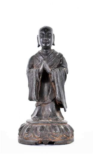 CHINESE BRONZE FIGURE OF A PRIEST