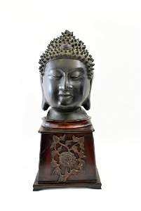 SOUTHEAST ASIAN PATINATED BRONZE HEAD OF A BUDDHA