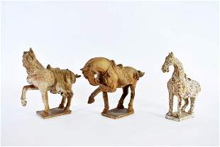 PAIR OF CHINESE MING STYLE EARTHENWARE HORSES