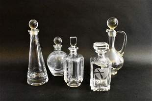 FIVE VARIOUS COLORLESS GLASS DECANTERS