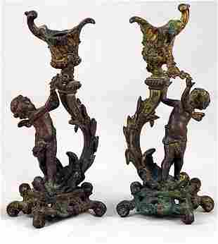Pair of French Putti Figural Candlesticks