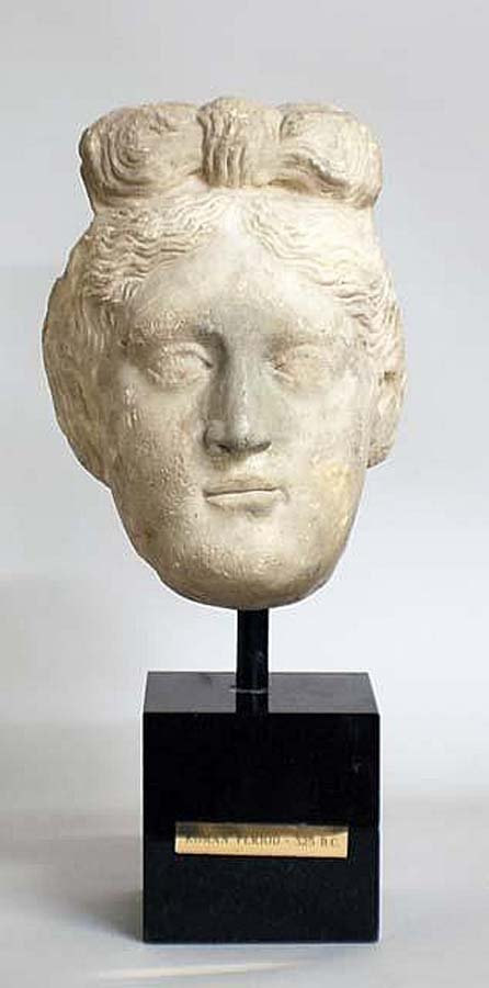 232: CARVED MARBLE HEAD OF A ROMAN FEMALE