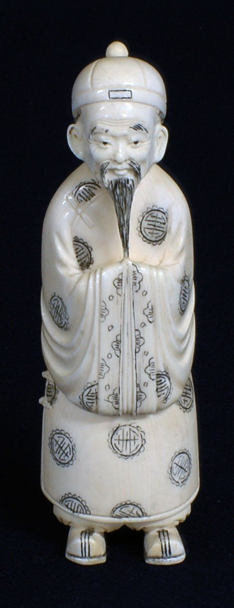 5: CARVED IVORY FIGURE OF A MAN