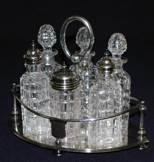 11: VICTORIAN SILVER PLATED AND GLASS CRUET STAND