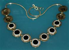 114: 14 KT YG, ONYX AND DIAMOND SUITE OF JEWELRY