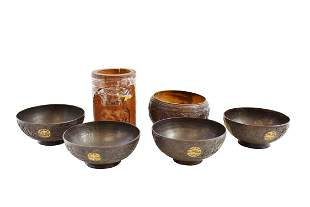 FOUR CHINESE CARVED COCONUT CUPS, ANOTHER & A BAMBOO