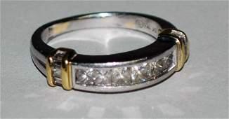 180: PLATINUM AND EIGHTEEN KARAT GOLD DIAMOND BAND
