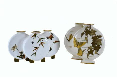 TWO ROYAL WORCESTER GILT DECORATED BUD VASES
