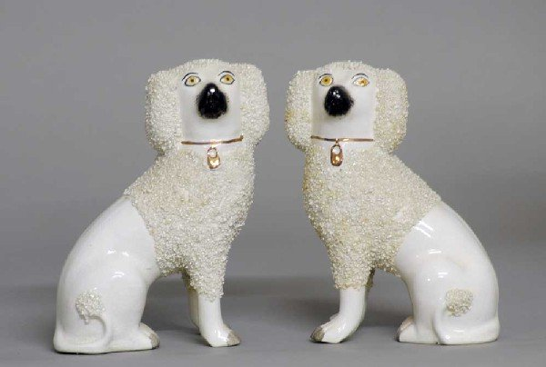 8: PAIR OF STAFFORDSHIRE POTTERY FIGURES OF DOGS