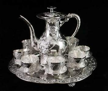 294: FINE AND UNIQUE EXPORT SILVER TEA SERVICE ON STAND