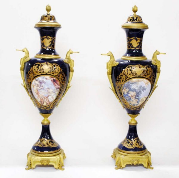 157: MONUMENTAL PAIR OF PORCELAIN URNS, COVERS AND STAN